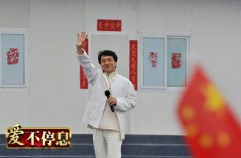 "The 55-year-old star, best-known for his martial arts films, came to Beichuan Middle School, one of the worst-hit schools in the quake, to sing a song titled ""Nation"" with students there."