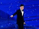 "Andy Lau sings the theme song ""Flying with the Dream"""