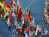 Flags of different delegations enter the field