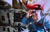 Astronauts assemble EVA suit for spacewalk