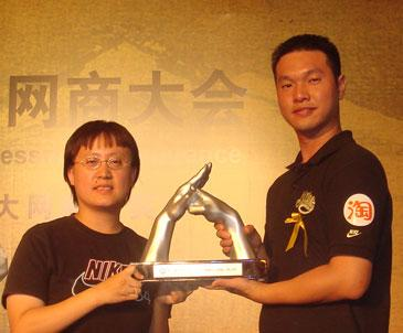 "Chen Hanjun and his wife, a deaf couple in Xiamen, are hailed as ""Top 10 e-Business Champions"" in the eastern Chinese city of Hangzhou on August 2."