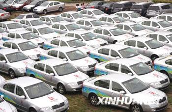 A fleet of one hundred cars are on display at Beijing's Asian Games Village Auto Trade Market on Sunday, September 7, 2008, gearing up for a upcoming auto auction. The cars, all SKODA Octavia 1.6L models, were mainly used in services affiliated to the Beijing Olympic Games and have attracted crowds of visitors. [Photo: Xinhuanet]