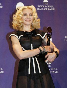 "Madonna - The Material Girl - also known as the Queen of Pop now stands among musical greats - in the ""Rock and Roll Hall of Fame."""