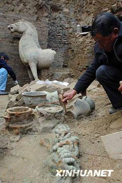 An excavation of a tomb has unearthed the largest bronze horse ever discovered in an ancient ruin.