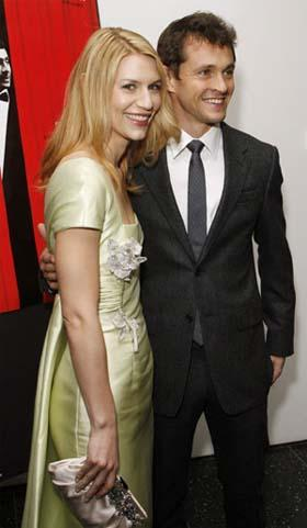 'Actress Claire Danes arrives with actor Hugh Dancy at the premiere of the film