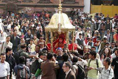 Relatives carry the Living Goddess Kumari (C), as she is brought to witness of the Ghode Jatra or Horse Racing Festival in Kathmandu, capital of Nepal, on March 26, 2009. The traditional Ghode Jatra was celebrated in Kathmandu on Thursday. Nepali Army usually organizes horse racing, acrobatics performance and other activities to mark the annual festival. It is believed that the clamor of horses' hooves on Ghode Jatra keeps the spirit of the demon Tundi at bay.(Xinhua/Bimal Gautam)