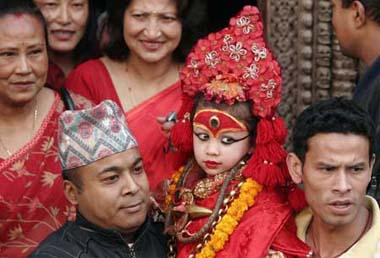 Relatives carry the Living Goddess Kumari (C), as she is brought to witness of the Ghode Jatra or Horse Racing Festival in Kathmandu, capital of Nepal, on March 26, 2009. (Xinhua/Bimal Gautam)