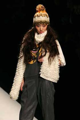 'A model presents a creation at a show of MISS SUN Fashion Collection during 2009 China Fashion Week held in Beijing, capital of China, March 26, 2009. The theme of the show is