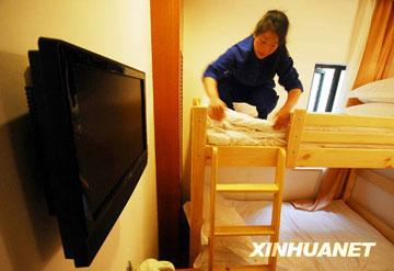 Also under construction are a number of hostels in downtown areas which will offer bunk beds to tourists at around 100 yuan (US$14.63) a night. [Photo:Xinhuanet]