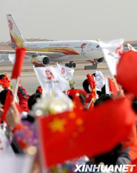 A chartered Air China plane carrying the Beijing Olympic flame touched down at the Beijing Airport Monday morning.