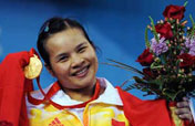 Chen Xiexia wins China 1st gold medal at Beijing Olympics