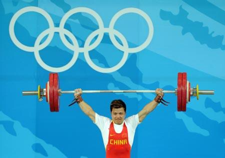 Zhang Xiangxiang of China takes a lift during men's weightlifting 62kg Group A competition of Beijing 2008 Olympic Games at Beijing University of Aeronautics & Astronautics Gymnasium in Beijing, China, Aug. 11, 2008. Zhang won the gold medal in the event. (Xinhua/Yang Lei)