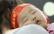 Baby fans watch Beijing Games