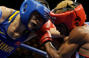 Chinese boxers into last 16, Russian world champion out