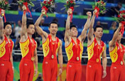Chinese men storm to gymnastics team gold at Beijing Olympics