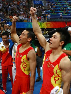 China's Li Xiaopeng (R) and Xiao Qin jubilate after gymnastics artistic men's team final of the Beijing 2008 Olympic Games at National Indoor Stadium in Beijing, China, Aug. 12, 2008. The Chinese team claimed the title of the event with 286.125 points. (Xinhua/Ren Long)
