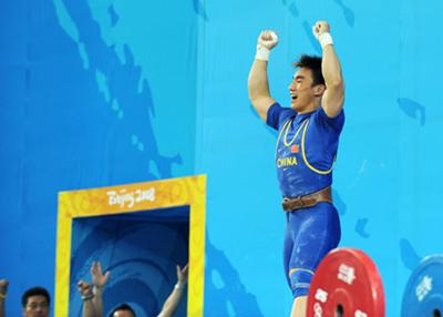 Liao Hui of China celebrates after taking a successful lift during the men's 69kg final of weightlifting at Beijing 2008 Olympic Games in Beijing, China, Aug. 12, 2008. Liao won the gold medal with a total of 348 kilos.(Xinhua Photo)