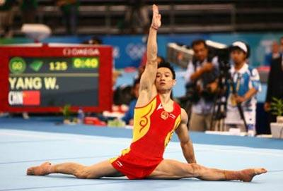 Yang Wei of China performs on the floor during gymnastics artistic men's individual all-around final of Beijing 2008 Olympic Games at National Indoor Stadium in Beijing, China, Aug. 14, 2008.(Xinhua Photo)