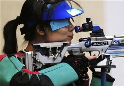 Gold medallist Du Li of China takes aim in the women's 50m rifle 3 positions shooting competition at the Beijing 2008 Olympic Games