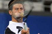 Djokovic through Olympic singles quarterfinal