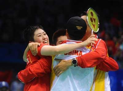 Yu Yang/Du Jing of China celebrate the victory over Lee Kyungwon/Lee Hyojung of South Korea during women's doubles gold medal match of the Beijing 2008 Olympic Games badminton event in Beijing, China, Aug. 15, 2008. Yu Yang/Du Jing beat Lee Kyungwon/Lee Hyojung 2-0 and claimed the gold. (Xinhua/Luo Xiaoguang)