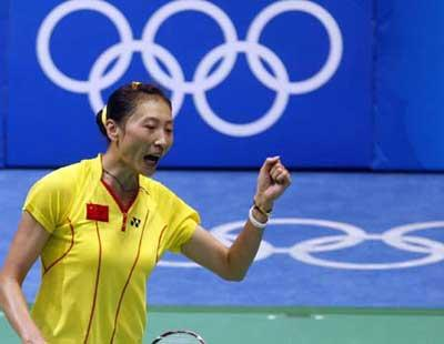 Zhang Ning of China celebrates for a point while competing against teammate Xie Xingfang at the women's singles gold medal match during the Beijing 2008 Olympic Games badminton event, in Beijing, China, Aug. 16, 2008. Zhang Ning won the match 2-1 and grabbed the gold medal of the event. (Xinhua/Zhang Chen)