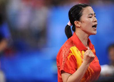 Wang Nan of China celebrates after defeating Feng Tianwei of Singapore during the women's team gold medal contest of Beijing Olympic Games table tennis event between China and Singapore in Beijing, China, Aug. 17, 2008. China beat Singapore 3-0 and claimed the title in this event. (Xinhua Photo)
