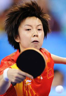 Zhang Yining of China returns the ball during the women's team gold medal contest of Beijing Olympic Games table tennis event between China and Singapore in Beijing, China, Aug. 17, 2008. China beat Singapore 3-0 and claimed the title in this event.(Xinhua Photo)