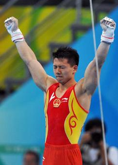 China's Chen Yibing gestures after performing on the rings during gymnastics artistic apparatus finals of Beijing 2008 Olympic Games at National Indoor Stadium in Beijing, China, Aug. 18, 2008. Chen Yibing claimed the title of the event with a score of 16.600. (Xinhua/Wang Lei)