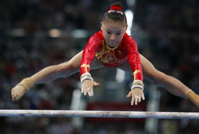 He Kexin of China performs on the uneven bars during women's uneven bars final of Beijing 2008 Olympic Games gymnastics artistic event at National Indoor Stadium in Beijing, China, Aug. 18, 2008. He Kexin claimed the title of the event with a score of 16.725. (Xinhua Photo)