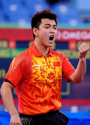 Wang Hao of China celebrates after defeating Dimitrij Ovtcharov of Germany during the men's team gold medal contest between China and Germany of Beijing Olympic Games table tennis event in Beijing, China, Aug. 18, 2008. China beat Germany 3-0 and claimed the title in this event. (Xinhua Photo)