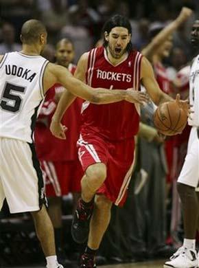 Houston Rockets' Luis Scola (4), of Argentina, begins to celebrate in the closing moments of the Rockets' 87-85 win over the San Antonio Spurs in an NBA basketball game in San Antonio on Sunday, March 22, 2009.(AP Photo/Delcia Lopez)