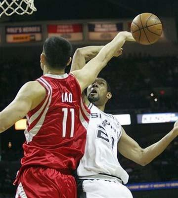 Houston Rockets' Yao Ming (11) blocks a shot by San Antonio Spurs' Tim Duncan (21) during the first quarter of an NBA basketball game in San Antonio on Sunday, March 22, 2009.(AP Photo/Delcia Lopez)