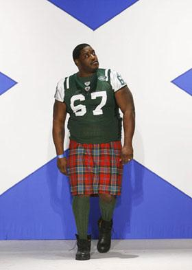 'NFL New York Jets player Damien Woody presents a creation during a