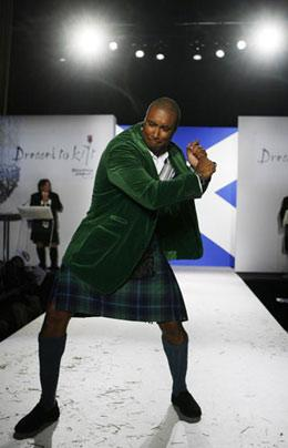 'Former MLB New York Yankee Bernie Williams walks down the runway in a kilt during a