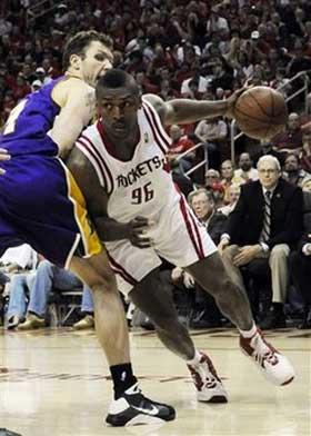 Houston Rockets' Ron Artest (96) drives the the basket as Los Angeles Lakers' Luke Walton (4) defends during the second half of Game 4 of their second round Western Conference NBA playoff basketball series Sunday, May 10, 2009 in Houston. The Rockets won 99-87.(AP Photo/Pat Sullivan)