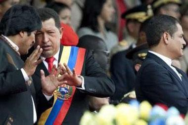 Boliva's President Evo Morales (L), Venezuela's President Hugo Chavez (C) and Ecuador's President Rafael Correa attend a military parade to celebrate the 188th anniversary of the battle of Carabobo in Valencia, some 180 km (112 miles) west from Caracas June 24, 2009.REUTERS/Carlos Garcia Rawlins