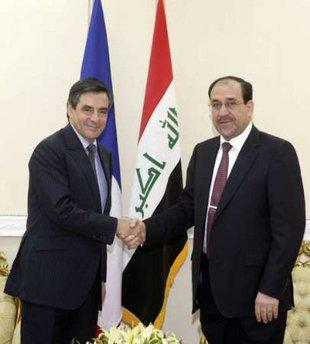 France's Prime Minister Francois Fillon (L) shakes hands with Iraq's Prime Minister Nuri al-Maliki during a meeting in Baghdad July 2, 2009.REUTERS/Iraqi Government/Handout(IRAQ POLITICS)