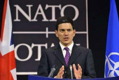 British Foreign Secretary David Miliband addresses a news conference at NATO headquarters in Brussels July 27, 2009.REUTERS/NATO photos/Handout